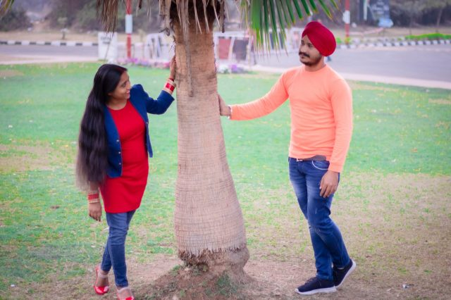 A Sikh couple under a tree