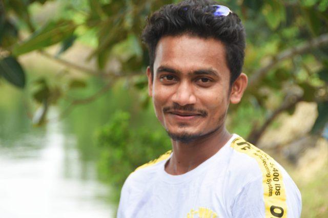 Boy posing while smiling