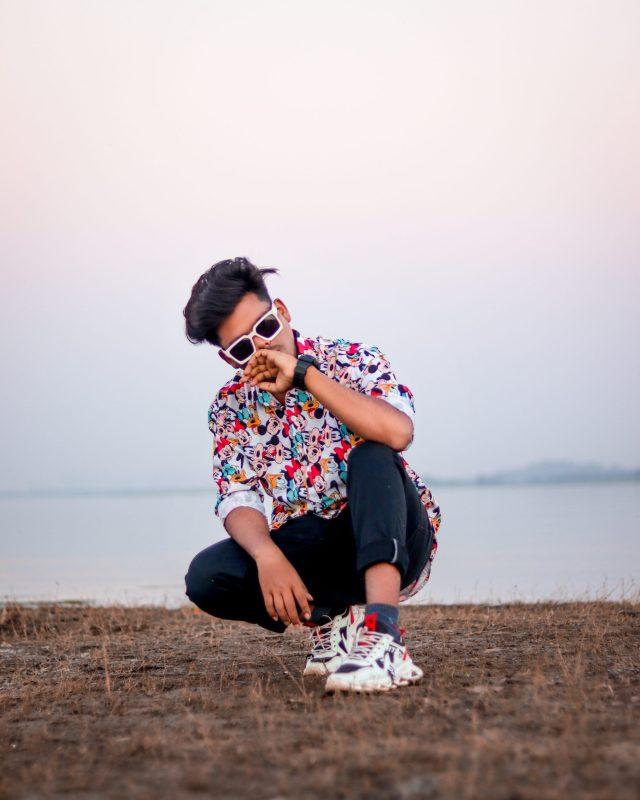 Boy posing near the sea