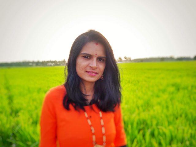 Girl posing in the crop farm