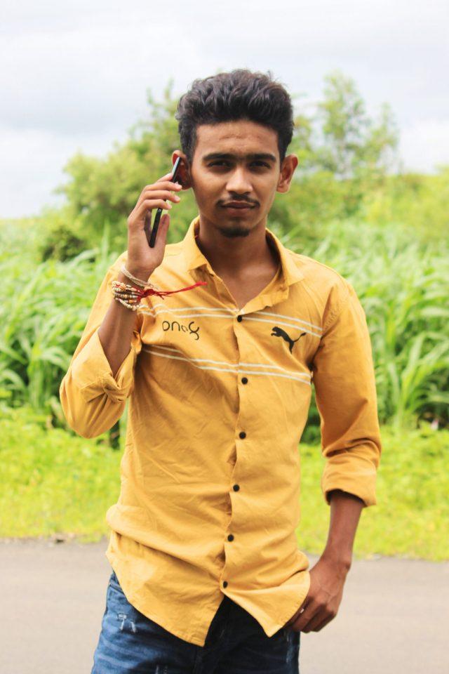 Boy posing with phone