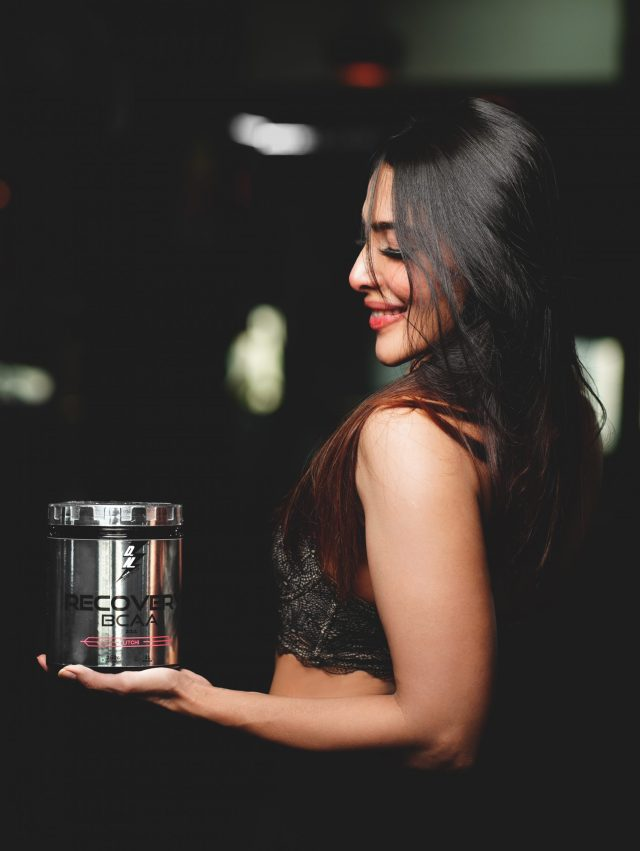 A girl with a supplement box