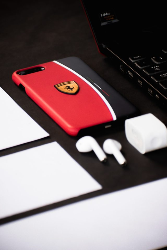 A phone cover and bluetooth earphones