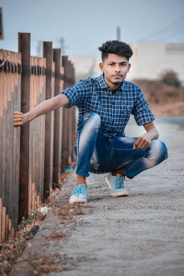 Stylish boy posing while sitting