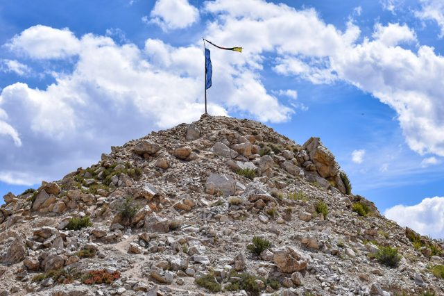 Flag waving on top of the mountain