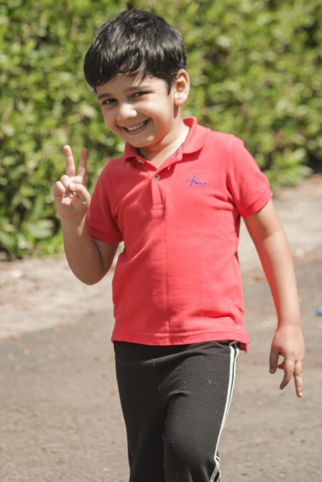 A happy kid pointing finger