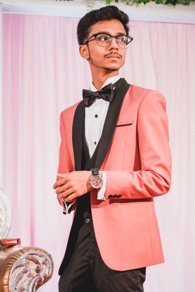 Boy posing in formal dress