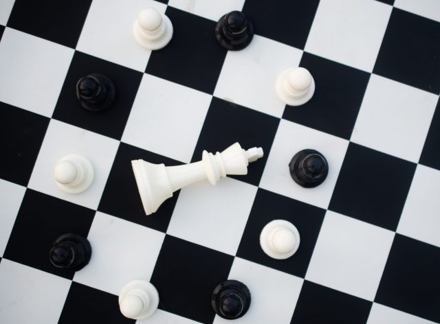 White king down in the circle of pawn