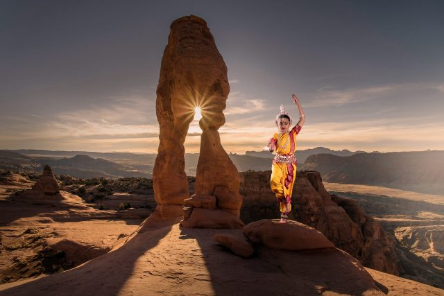 A classical dancer on a hill top