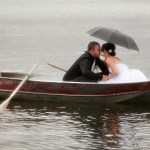 Wedding couple on lake and in boat