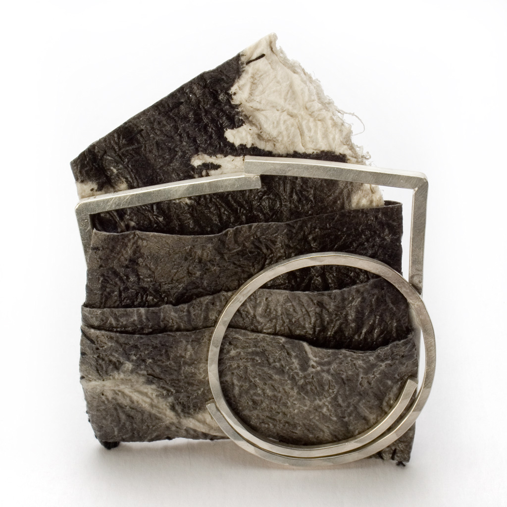 "Myung Urso - ""Sense"" (2008). Brooch. Mulberry paper, oriental ink, thread, lacquer, sterling silver."