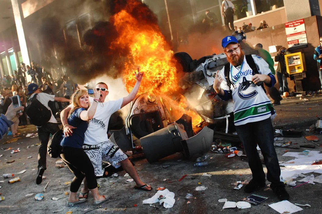 15 Jun 2011, Vancouver, British Columbia, Canada --- June 15, 2011 - Vancouver, British Columbia, Canada - Violence broke out Wednesday evening following the Vancouver Canucks' defeat to the Boston Bruins in Game Seven of the Stanley Cup Finals. Cars were set on fire and shops were looted following the ice hockey team's 4-0 defeat to the Boston Bruins. --- Image by ? Sergei Bachlakov/ZUMA Press/Corbis