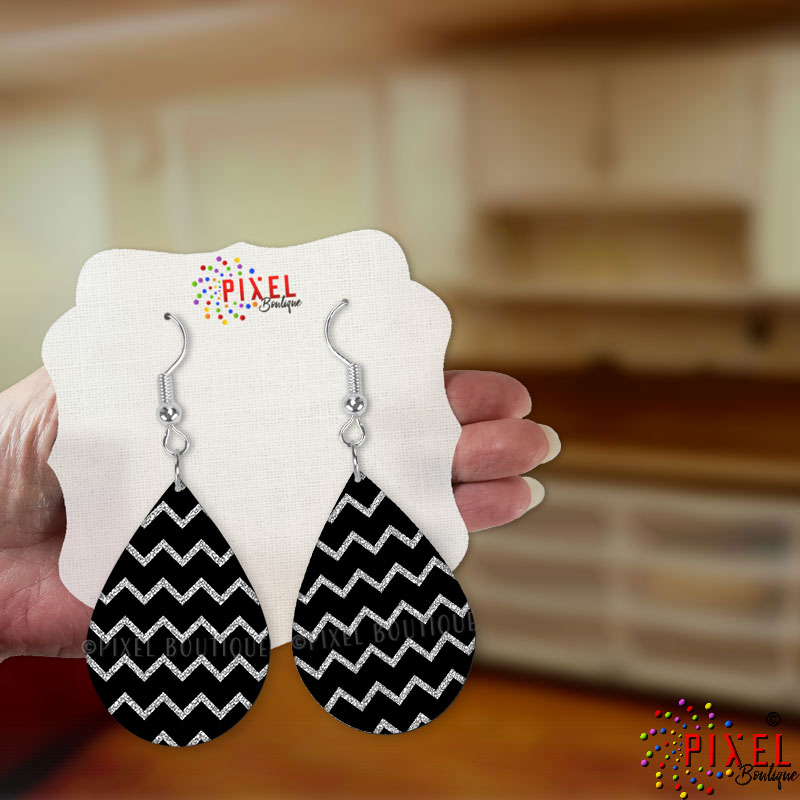 Silver Glitter Chevron Earrings in hand
