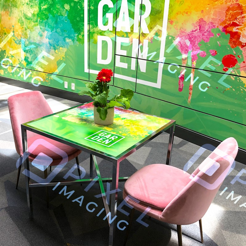 Custom-printed vinyl wrap event décor/decorations on walls and glass tables.