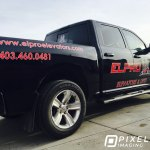 Company logo vinyl decals, phone number decals, and website URL decals on a company work pickup truck.