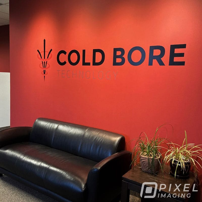 """Wall Decals & Graphics Calgary - A newly insalled wall graphic bearing the text """"COLD BORE"""" at a Calgary Business."""