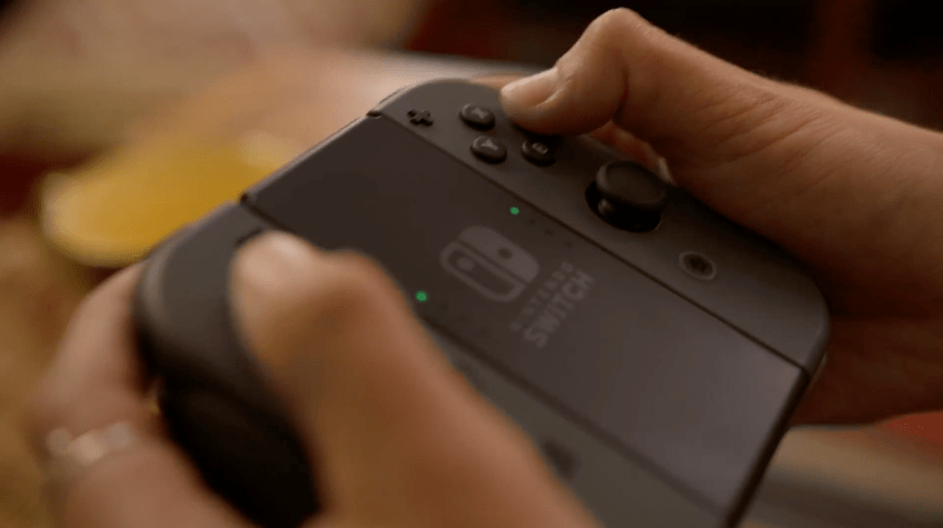 Nintendo Joy-Con controllers connected to the Joy-Con Grip accessory