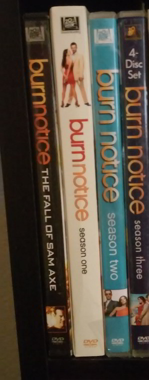 DVD spines of a few seasons of BURN NOTICE