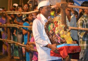 Man carries a Ganesh idol for immersion