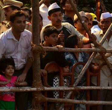 Kids and adults watch Ganapati immersion