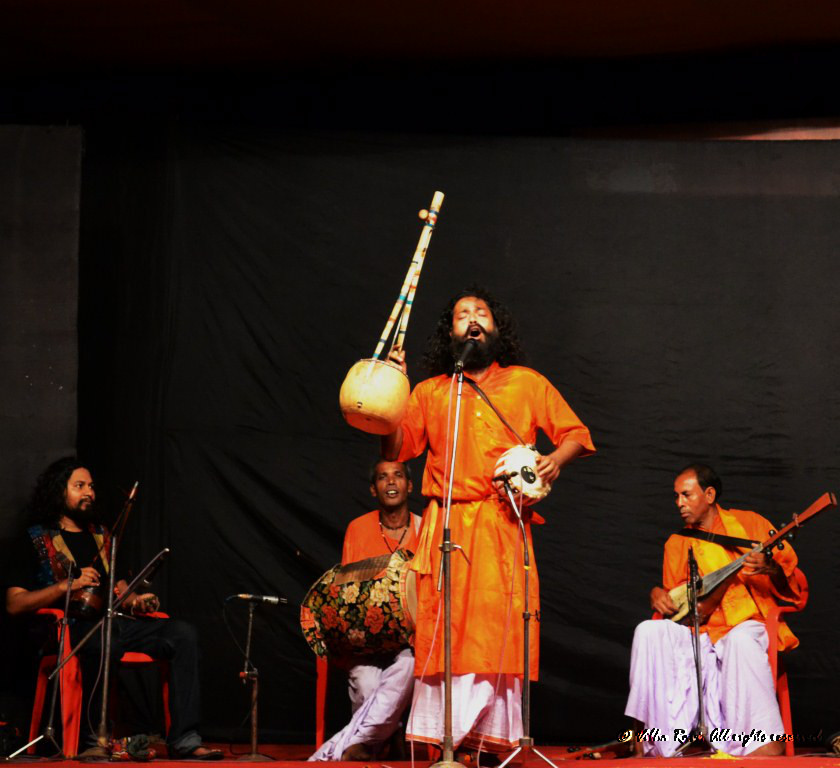 A Baul sings at a Durga Pooja celebration