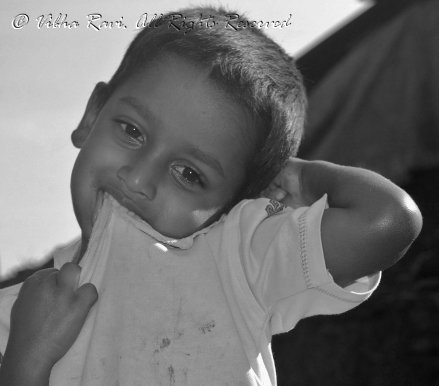 Indian boy feels shy as I take his picture