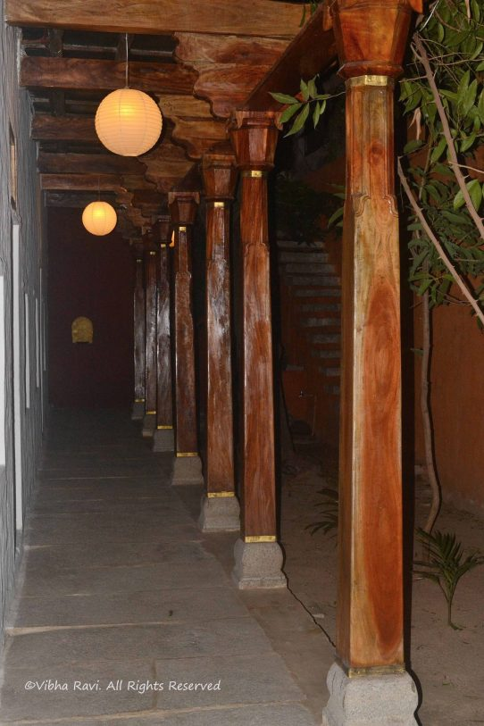 Wooden pillars support the Uramma House, giving it a pleasing look