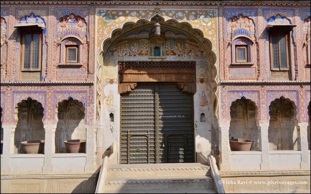 The double doors at Nadine Haveli in Fatehpur show smaller doors set in the panels