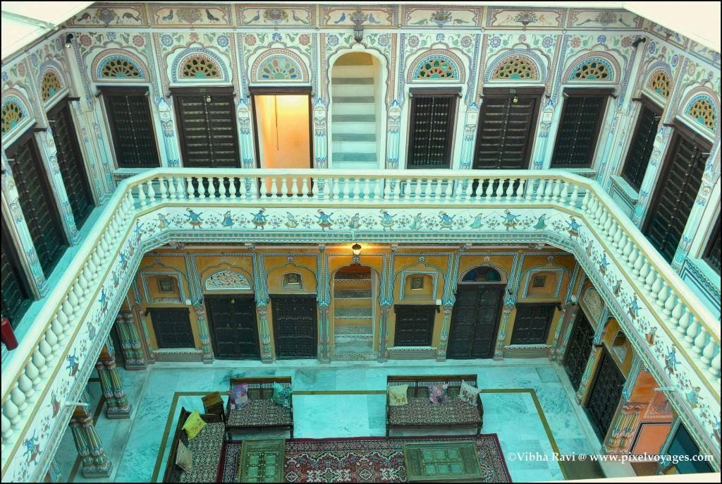 At Radhika Haveli in Mandawa, you can see the courtyard and steps leading up to upper floors
