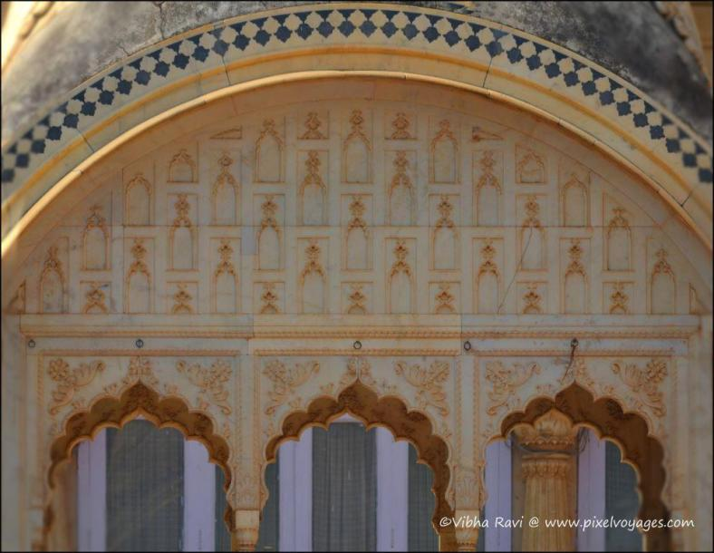 Close up of a chhatri at the City Palace, Alwar, shows marble inlay work and carvings