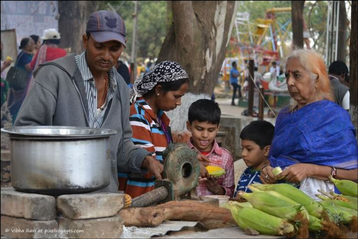 A vendor sells corn on the cob by Saputara Lake