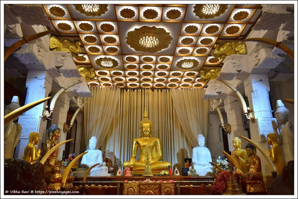 A hall with Buddha statues at Tooth Relic Temple, Kandy