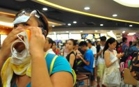 Moments after tear-gas is deployed, the crowd rushes into a nearby MacDonald's just outside Admiralty Centre. A young lady with a fever patch on her forehead makes a distressed call