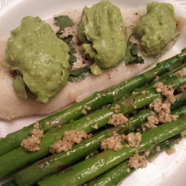 Whiting with avocado sauce and garlic asparagus