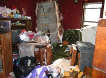 """Piles of junk and rotting food greeted Erie police officers and FBI agents when they searched Marjorie Diehl-Armstrong's house after September 21, 2003. They were looking for evidence that she fatally shot her boyfriend Jim Roden and helped place his body in a freezer in Bill Rothstein's garage. Diehl-Armstrong had history of hoarding government-surplus food. """"I've dealt with corpses with the flesh falling off. This is worse,"""" a veteran Erie police officer said of Diehl-Armstrong's house. FBI photo, used as evidence at trial"""