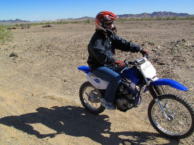 KT tears up the desert on her TTR.