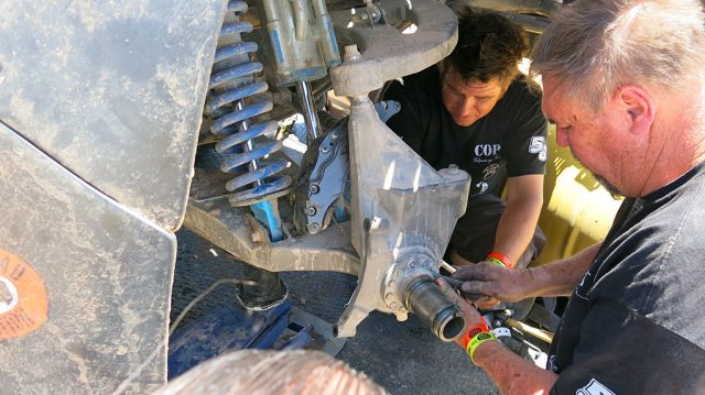 Dennis and Corey and Mike swap out the #250's wheel bearing with the broken #29's bearing.
