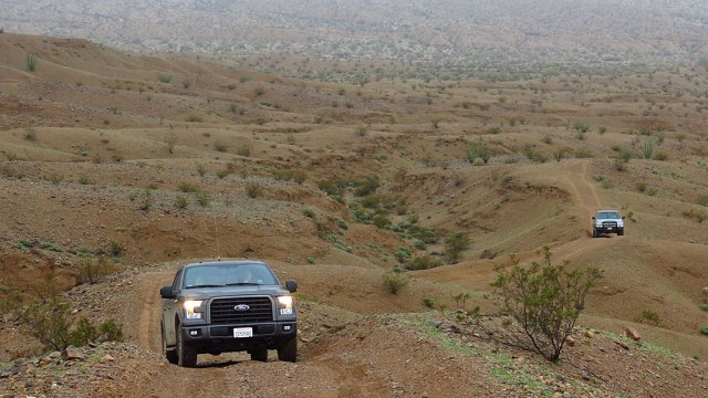 Matt's new F-150 leads Henri and Robert up the jeep trail.