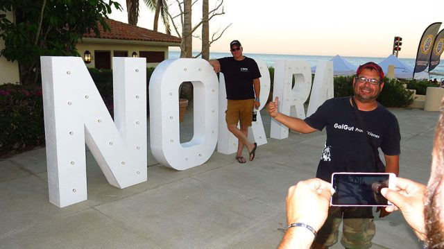 Steve attempts to get a photo by the really big NORRA sign.