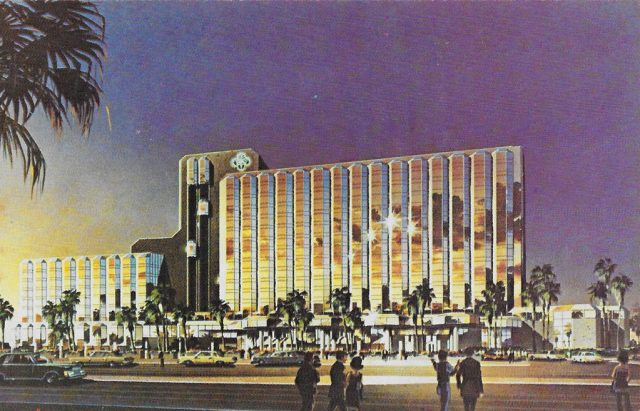 On back: FUTURE LOOK ... Artist's rendering depicts the future look of the all new Desert Inn and Country Club. When completed, the resort will house a spacious new casino and lavish shops and luxurious restaurants. Completion scheduled for mid-1978.