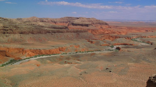 As the road climbed in elevation, we got some great views of Bullfrog Creek and the surrounding red cliffs.