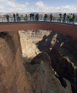 Tourists walk on the glass-bottomed Skywalk that extends 70 feet over the edge of Grand Canyon West's Eagle Point, Wednesday, March 28, 2007, in northwestern Arizona. The Grand Canyon Skywalk opened to the general public on the Hualapai Indian Reservation. (AP Photo/The Arizona Republic, Rob Schumacher) ** MARICOPA COUNTY OUT, MESA TRIBUNE OUT, MAGS OUT, NO SALES **