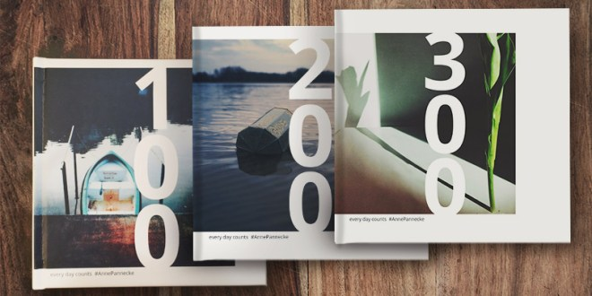 3 Instagram photo books on wood table
