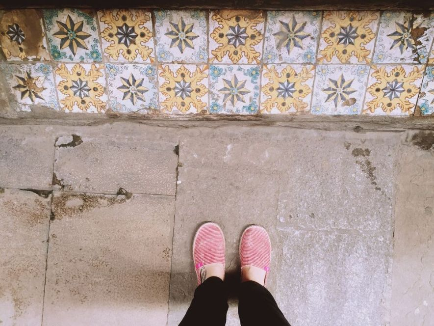 look down to some colorful tiles - Barcelona streets