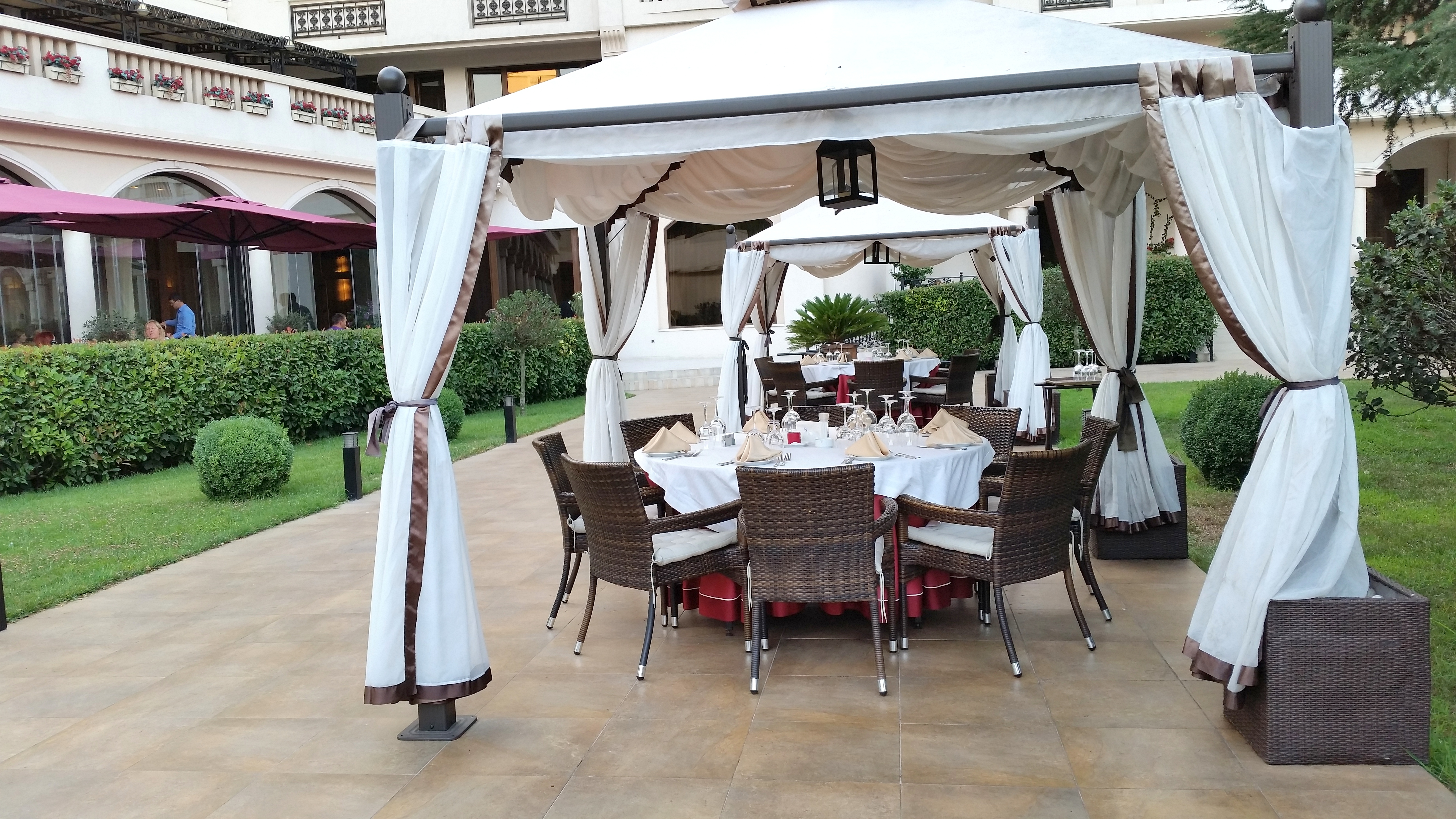 Cozy tables under the white gazebos at Salini by placescases.com