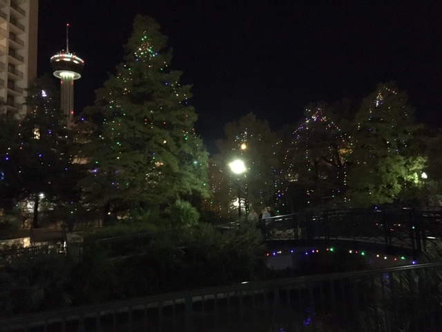 A view of the Tower from the Riverwalk during Christmastime.