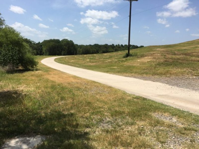 The open concrete trail at Pearsall Park in the hot sun.