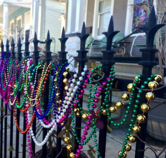 beads-on-fence-mardi-gras