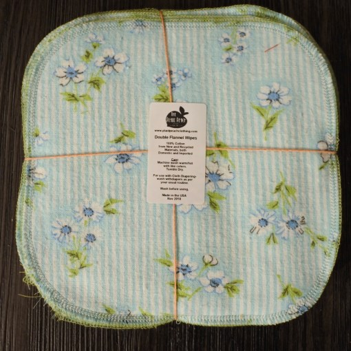 Square of blue striped fabric with blue flowers