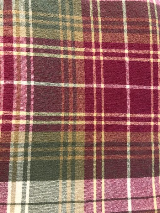Raspberry, sage, cream and tan plaid fabric.